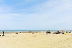 People on sandy beach near Blonville-sur-mer Stock Photos