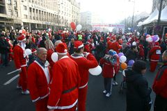 People in Santa Claus costumes take part in the race Royalty Free Stock Images