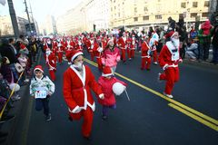 People in Santa Claus costumes take part in the race Royalty Free Stock Photos