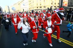 People in Santa Claus costumes take part in the race Stock Photography