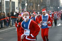 People in Santa Claus costumes take part in the race Stock Photos