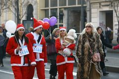 People in Santa Claus costumes take part in the race Stock Photo