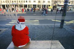 People in Santa Claus costumes take part in the race Royalty Free Stock Photo