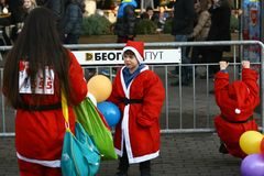 People in Santa Claus costumes take part in the race Royalty Free Stock Image
