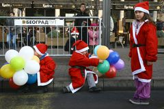 People in Santa Claus costumes take part in the race Royalty Free Stock Photography