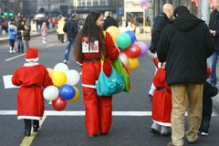 People in Santa Claus costumes take part in the race Stock Images