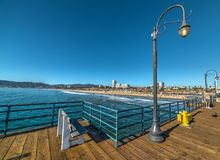 People in Santa Monica wooden pier. Los Angeles county. California, USA Stock Image