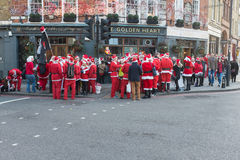 People in Santa outfits in London Royalty Free Stock Photos