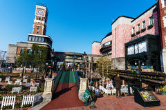 People at Sapporo Mechanical clock tower. SAPPORO, JAPAN -APRIL 25, 2016: Unidentified people near Sapporo Mechanical clock tower at Chocolate factory Shiroi royalty free stock photos