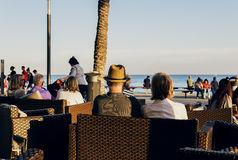 People sat in a terrace of torrevieja, Spain  with a view to the sea Royalty Free Stock Image