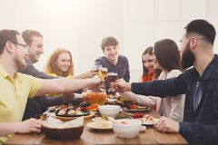 People say cheers clink glasses at festive table dinner party stock photography