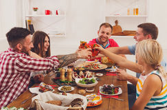People say cheers clink glasses at festive table dinner party Royalty Free Stock Photos
