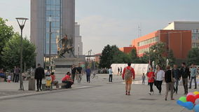 People on the Scanderbeg Square Pristina. PRISTINA, KOSOVO - JULY 01, 2015: People walking by the new fountain on Scanderbeg square in city center stock video