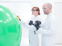 People scanning objects in lab Stock Image