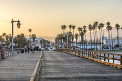 People at scenic old wooden pier in Santa Barbara in sunset Stock Photo