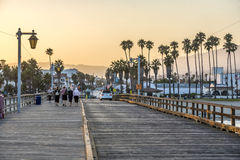 People at scenic old wooden pier in Santa Barbara in sunset Royalty Free Stock Image