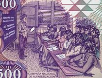 People at school during Nicaraguan Literacy Campaign on Nicaragu. A 500 cordoba 1985 banknote closeup, eradication of illiteracy in Nicaragua Royalty Free Stock Photo