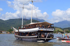 People on a schooner ride in Paraty-RJ, Brazil. Stock Photo