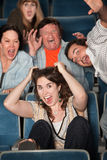 People Screaming In Theater. Group of people in audience scream in terror Royalty Free Stock Image