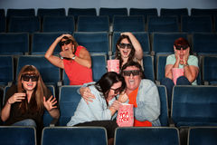 People Screaming In Theater. Group of scared people with 3d glasses screaming in a theater Royalty Free Stock Photo