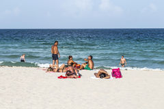 People at the sea side in South beach Stock Photography