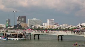 People in the seaport, Pattaya city and Gulf of Siam in Thailand stock video