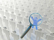 People search. Searching for the right person. Loupe over the blue human figure standing out of the grey crowd Royalty Free Stock Image