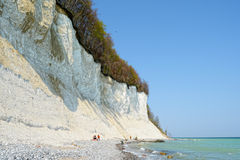People search fossiles on shore of chalk rock liff of Rugen isle Royalty Free Stock Image