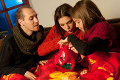 People searching in christmas bag. Girls and young men studying christmas bag Stock Image