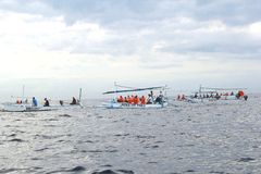 People are searching for dolphins at sunrise, Lovina, Bali, Indonesia Royalty Free Stock Photo