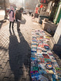 People searching for second hand books on the street Royalty Free Stock Images