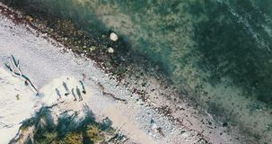 People by seashore from above stock footage