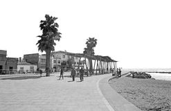 People on the seaside boardwalk. PORTIXOL/MOLINAR, MALLORCA, BALEARIC ISLANDS, SPAIN - APRIL 10, 2016: People on the seaside boardwalk on April 10, 2016 in Palma Royalty Free Stock Photography