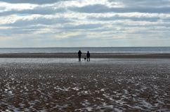 People in seaside at St Bees Royalty Free Stock Photography