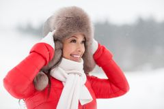 Happy smiling woman in winter fur hat outdoors Royalty Free Stock Photography