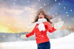 Happy woman in fur hat over winter background stock images