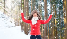 Happy woman in fur hat over winter forest stock photos