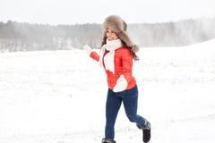Happy woman in winter fur hat having fun outdoors Stock Photos