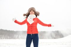 Happy woman in winter fur hat having fun outdoors Royalty Free Stock Photo