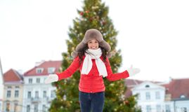 Happy woman over christmas tree in tallinn royalty free stock images