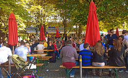 People seat  and chat at beer garden in Viktualienmarkt, Munich Royalty Free Stock Image