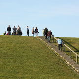 People on a seawall Royalty Free Stock Photography