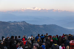 People are seeing the first light of new year`s day at dawn with mountain villages and Kangchenjunga mountain in winter. Royalty Free Stock Image
