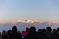 People are seeing the first light of new year`s day at dawn with mountain villages and Kangchenjunga mountain in winter. Stock Image