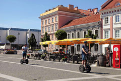 People on Segways at The Town Hall Square in Vilnius, Lithuania. Royalty Free Stock Photo