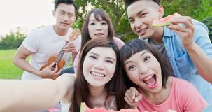 People enjoy at a picnic. People selfie happily and eat watermelon enjoy at a picnic royalty free stock photos