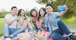 People selfie happily. People enjoy beer and selfie happily go on a picnic royalty free stock photography
