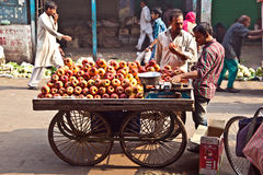 People sell apples at Chawri Bazar in Delhi, India Royalty Free Stock Image