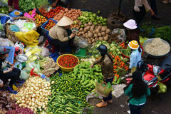 People sell and buy vegetables at open air market. DA LAT, VIET NAM- FEBRUARY 8, 2013