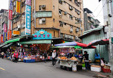 People sell foods on street at New Taipei district in Taipei, Taiwan.  Stock Photo